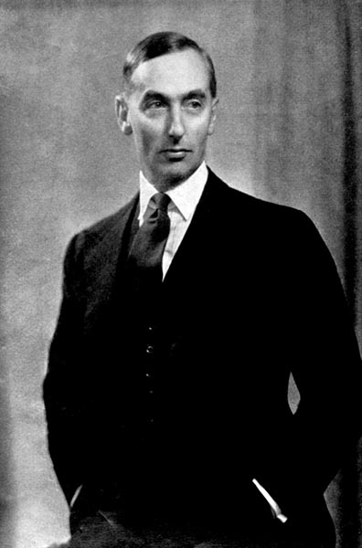 Black and White image of Jack Longland in a formal suit