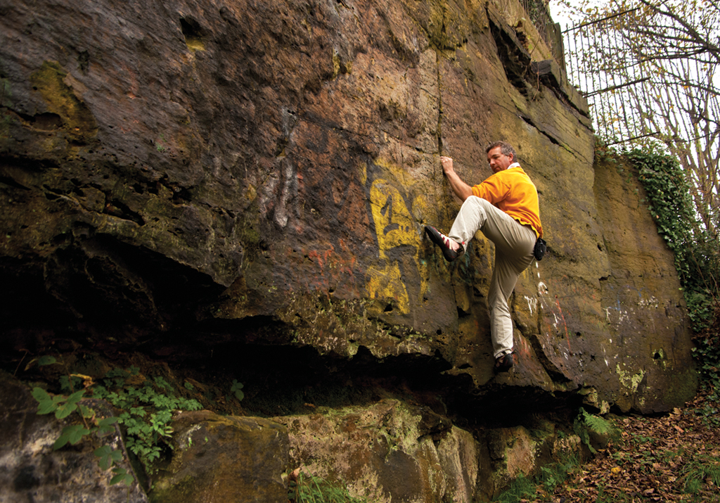 Jim Symon bouldering on Bluebell Wall, The Breck. Photo: Paul Evans