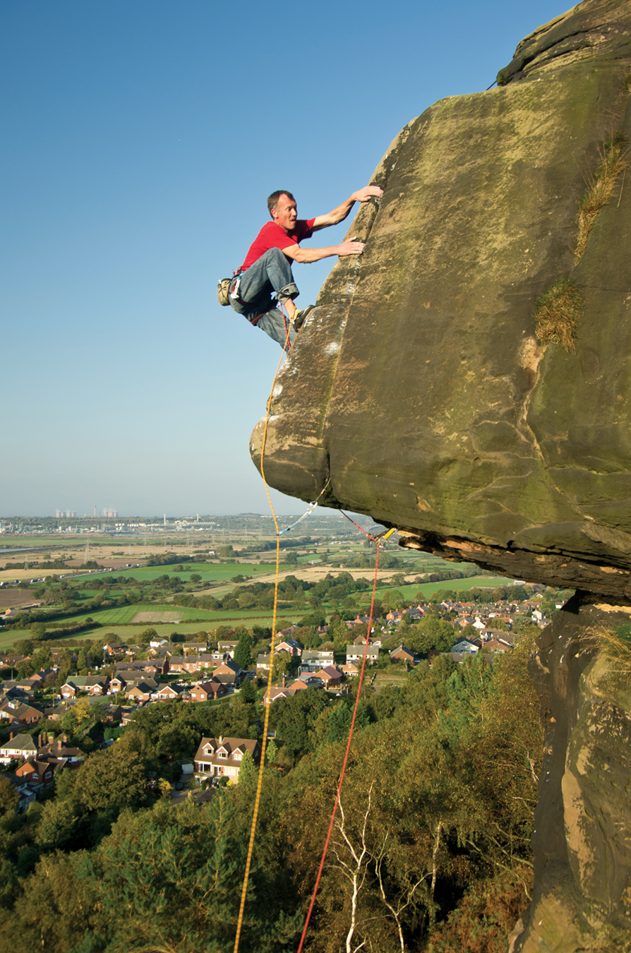 Pete Chadwick on Yuppies Arête at Helsby. This is the front cover of the BMC's Cheshire & Merseyside Sandstone guidebook. Photo: Paul Evans