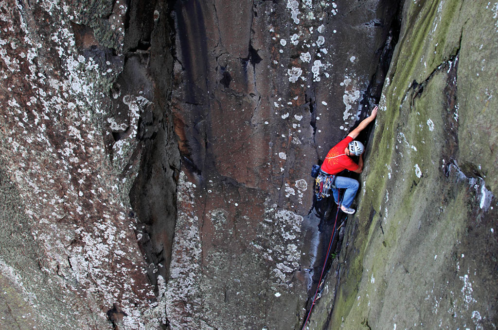 Simon Dale tackles the brilliant corner crack on the lower pitch of Equinox (E2 5b) at Rathlin Wall. Photo: Mike Hutton