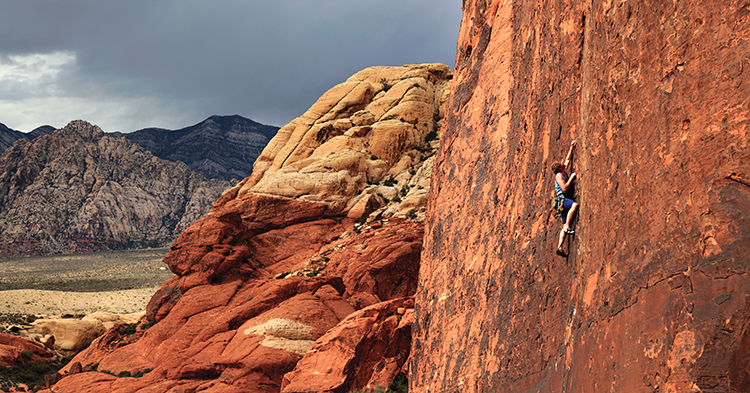 Steve Dunning on the eye-catching seam of Running Man (5.11c) before a storm chases its way into the Calico Hills. Photo: Mike Hutton