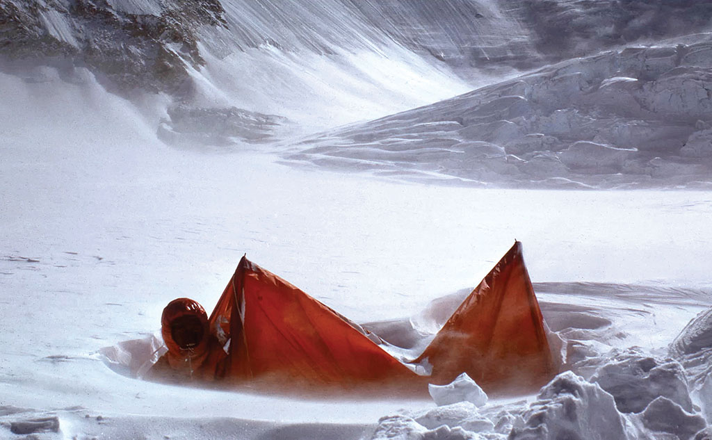 Hamish emerges from an avalanched tent on the 1975 South West Face of Everest expedition. Photo: Hamish MacInnes Collection