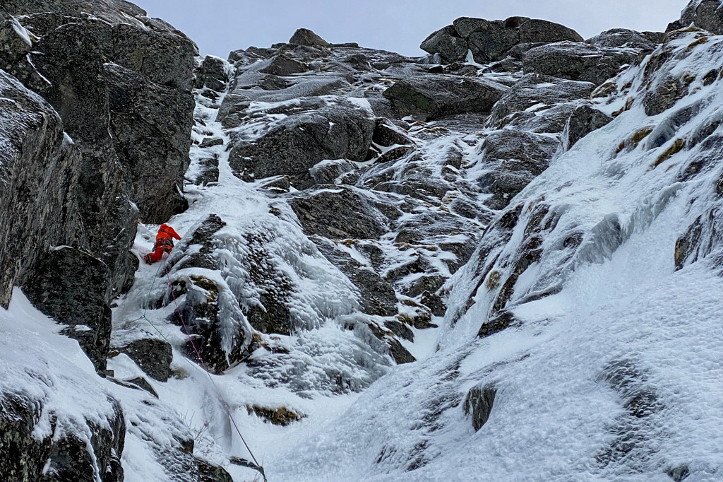 Jeff Mercier climbing their second objective, an existing route on Abrahamstind. Photo Greg Boswell