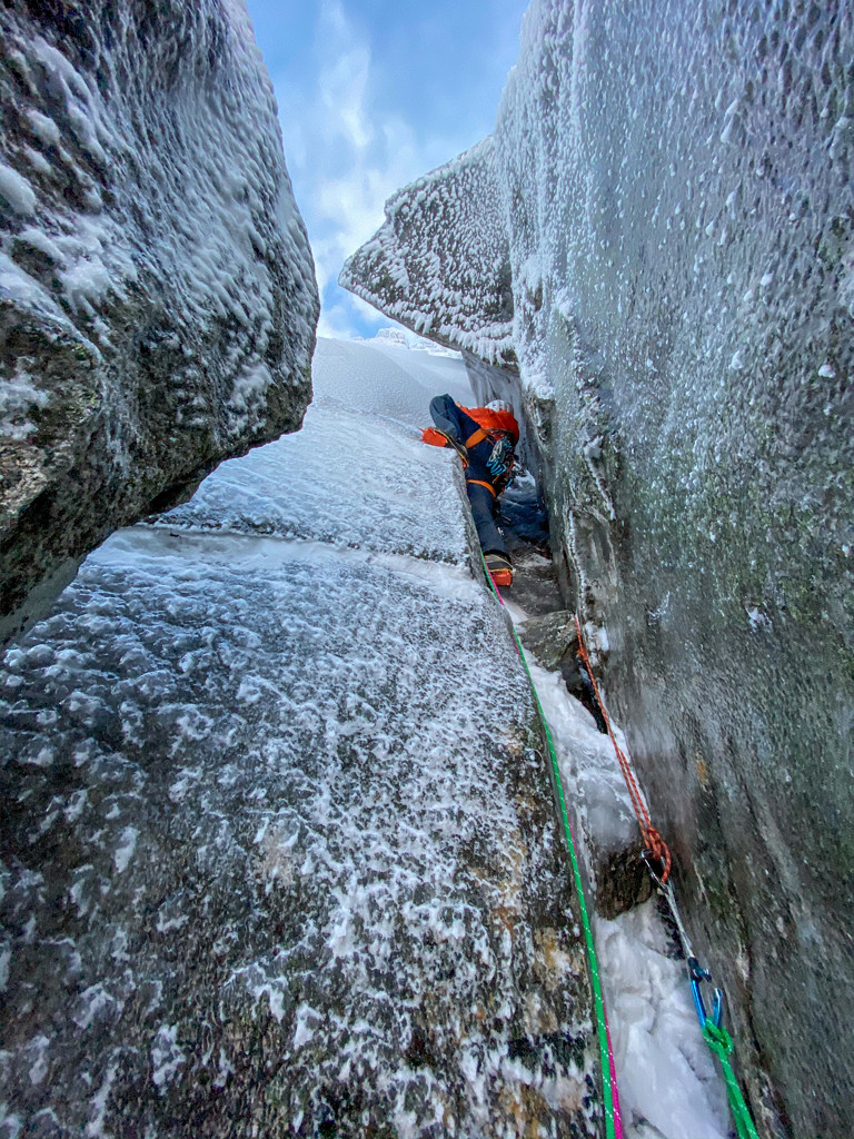 Jeff Mercier engrossed in super-thin climbing on their attempt of There and Back Again, a summer line on Mount Geitgaljen. Boswell and Mercier subsequently bailed out proving  that discretion is the better part of valour in some circumsatances! Photo Greg Boswell