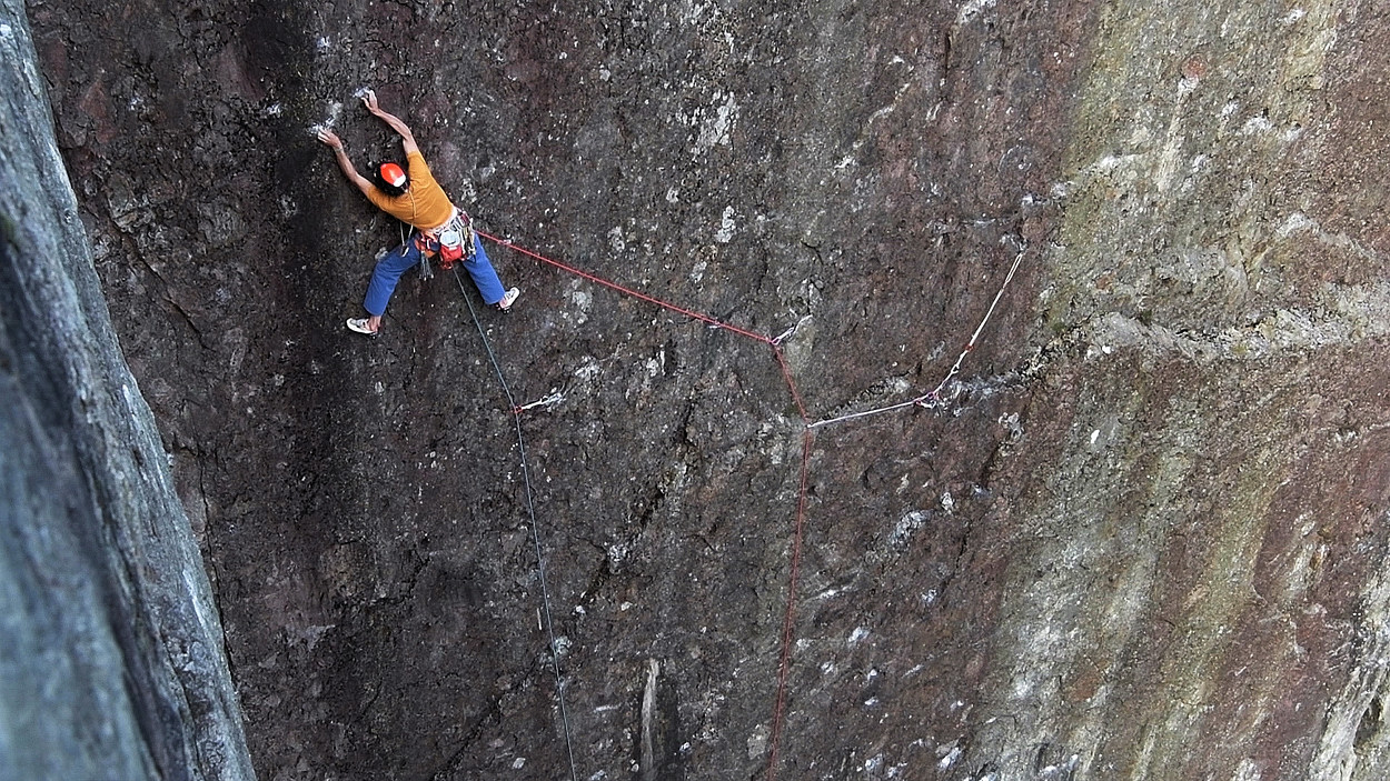 "Steve - having left the girdle ledge - approaches the crucial wire: ""I knew once I set off there was no stopping – I was going up, or I was coming off….. within reason! I'd already planned that I'd 're-assess', where I'd decide if going forward was a good idea. I assumed the first assessment was at the crucial wire – if I found it… "". Photo: Keith Sharples"