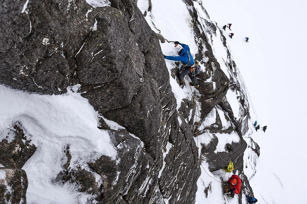 Host climber Luca Celano and Carl Nystedt from Sweden climbing Pot of Gold (V,6),Coire an t-Sneachda. Cairngorms. Photo: Marc Langley