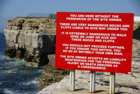 A modern warning sign! It doesn't leave much out… this one is found at White Hole, Portland, Dorset. Photo: Mike Robertson