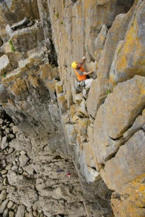 Knowing your tides and abseil points will get you ahead of the game; Mick Ryan in action on The Cracks (Severe), Mother Carey's, Pembroke. Photo: Mike Robertson
