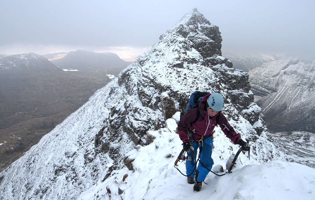 Kath Bromfield dispensing with the rope on the easier central section of the traverse of Liathach's superb Northern Pinnacles (II/III). Photo: Garry Smith