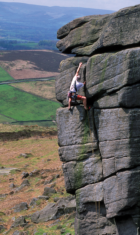 Stephen Coughlan climbing The File (VS 4c), Higgar Tor, Peak District. Photo: David Simmonite