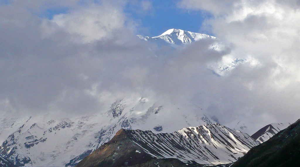 Lenin Peak emerging out of the clouds from base camp. Photo: © Richard Haszko