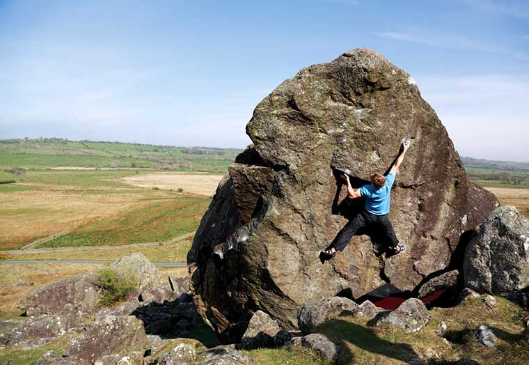 Adam Hocking on one of the hardest problems at Carrock Fell. Situated on the backside of Boardman's Boulder it's called Metronome and is graded at V11. Photo: © David Simmonite