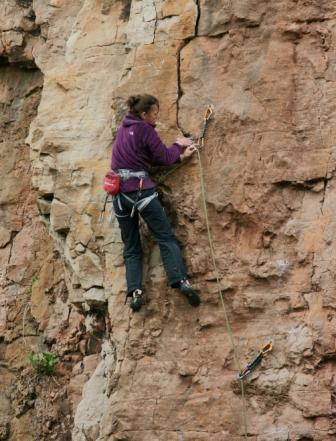 Libby Peter on Discomknockerated (F6b+) at Penmaen Head, Colwyn Bay. Here, a cross body clip comes in handy